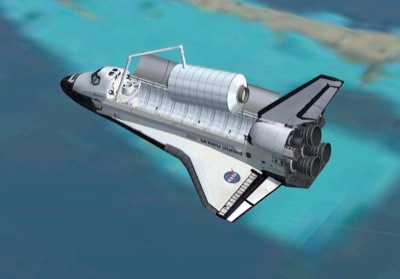 Space Shuttle Atlantis in orbit with cargo doors open