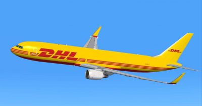 DHL Cargo Boeing 767-300 ER against a blue sky.