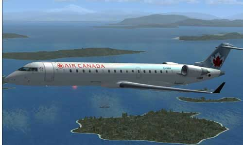 Air Canada Bombardier CRJ-700 flying over water.