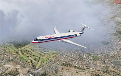 American Eagle CRJ-700 flying through clouds.