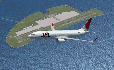 JAL Express Boeing 737-800 flying over airport.