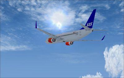 SAS Boeing 737-883 in flight.