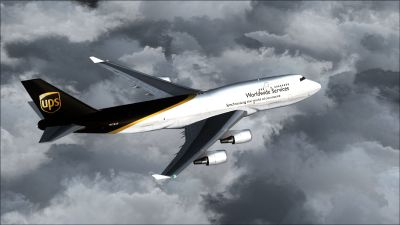 UPS Boeing 747-400F/BCF flying above clouds.
