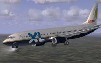 XL-Oger Tours Boeing 737-800 in flight.