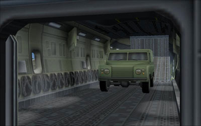 Cargo bay with military truck loaded