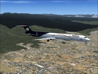 Aeromexico McDonnell Douglas MD-80 flying over town.
