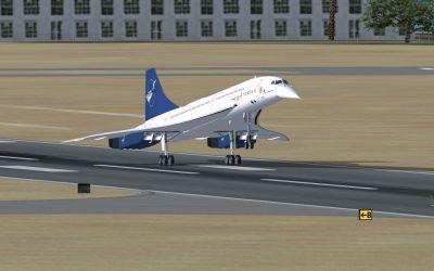 Aerospatiale Concorde landing on runway.