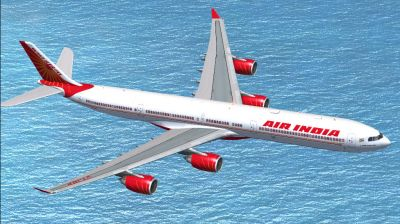 Air India Airbus A340-600 flying over water.