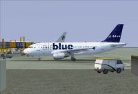 Airblue Airbus A319-112 on tarmac.