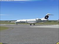Alaska/Skywest Airlines CRJ-700 on runway.