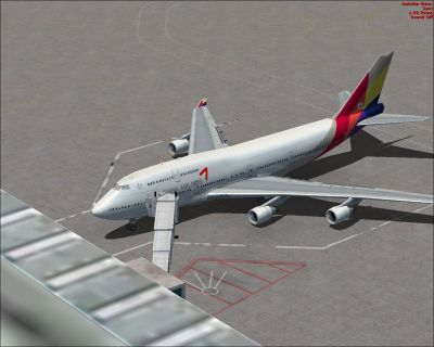 Asiana Boeing 747-400 at docking gate.
