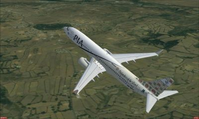 Pakistan International Airlines Boeing 737-800 ''Nowshera Defenders of the Land'' in flight.