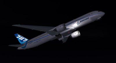 Boeing Flight Test Airplane 787-9 flying at night.
