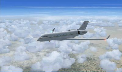 Bombardier Global Express XRS flying above clouds.