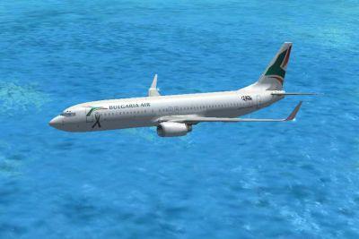 Bulgaria Air Boeing 737-800 flying over water.