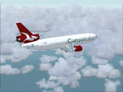 Cargoitalia McDonnell Douglas DC10/30F flying above clouds.
