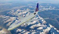 Continental Boeing 737-800 flying over mountains.