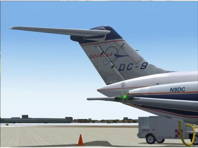The tail of a DC-9 in house livery