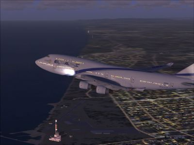 El Al Boeing 747-400 flying at night.