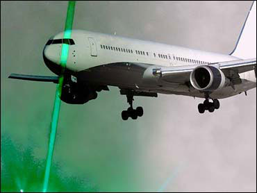 Green laser attacking landing aircraft