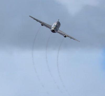 Lockheed L-1011 in flight with engine smoke effect.