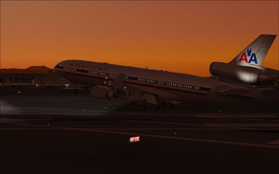 American Airlines MD-11 landing at dusk