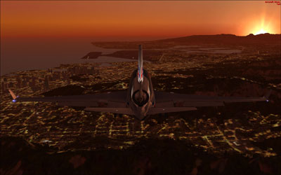 MD-11 at night flying over city