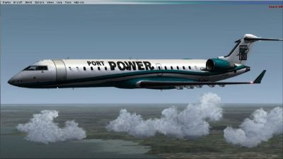 Port Power Logojet CRJ in flight.