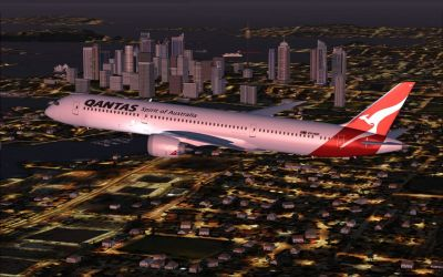 Qantas Boeing 787-9 flying at night.