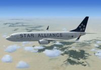 Star Alliance Boeing 737-800 in flight.