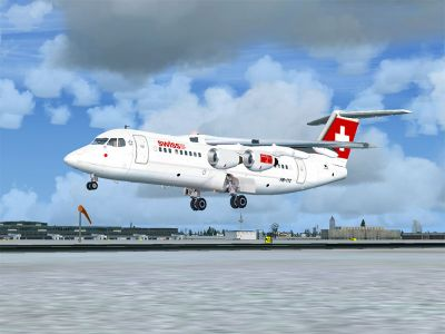 Swiss BAe Avro RJ100 landing on runway.