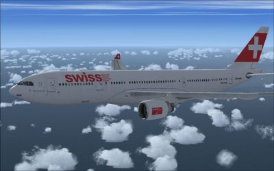 Swiss Airbus A330-223 flying above clouds.