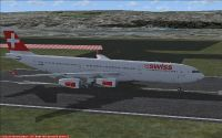 Swiss International Airlines A340-313X on runway.
