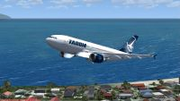 Tarom Airbus A310-300 flying over a coastal town.