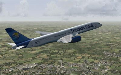 Thomas Cook UK Boeing 757-200 flying over countryside.