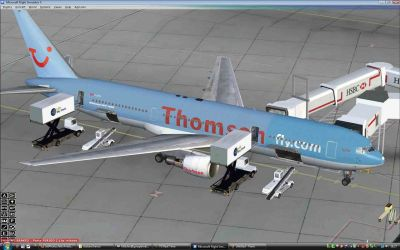 Thomsonfly Boeing 767-300 at boarding gates.