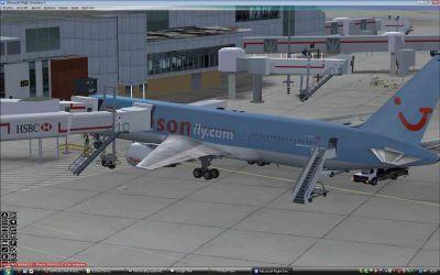 Thomsonfly Boeing 767-300 preparing at gates.