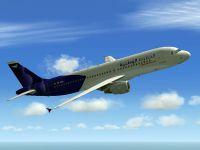 Wataniya Airways Airbus A320-214 in flight.