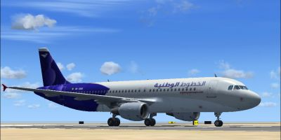 Wataniya Airways Airbus A320-214 on runway.