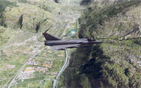 Military aircraft flying over valley in X-Plane.