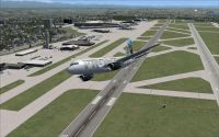 Screenshot of plane flying over Seattle Tacoma International Airport.
