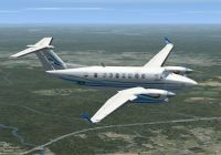 Screenshot of Beech King Air 350 With Blue Stripes in flight.