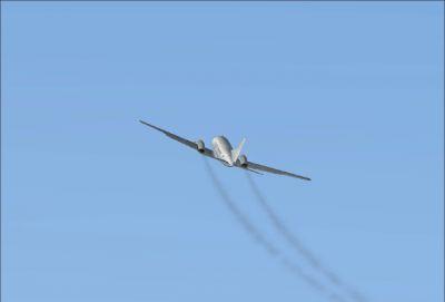 Screenshot of Convair CV580 in flight leaving smoke trails.
