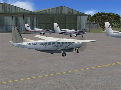 Screenshot of SafariLink Cessna 208B Grand Caravan parked near hangar.