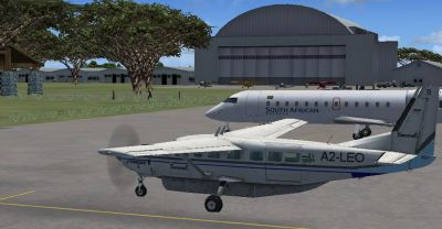 Screenshot of Sefofane Air Charters Cessna 208B parked near hangar.