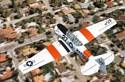 Screenshot of T-6G Texan in flight over residential area.