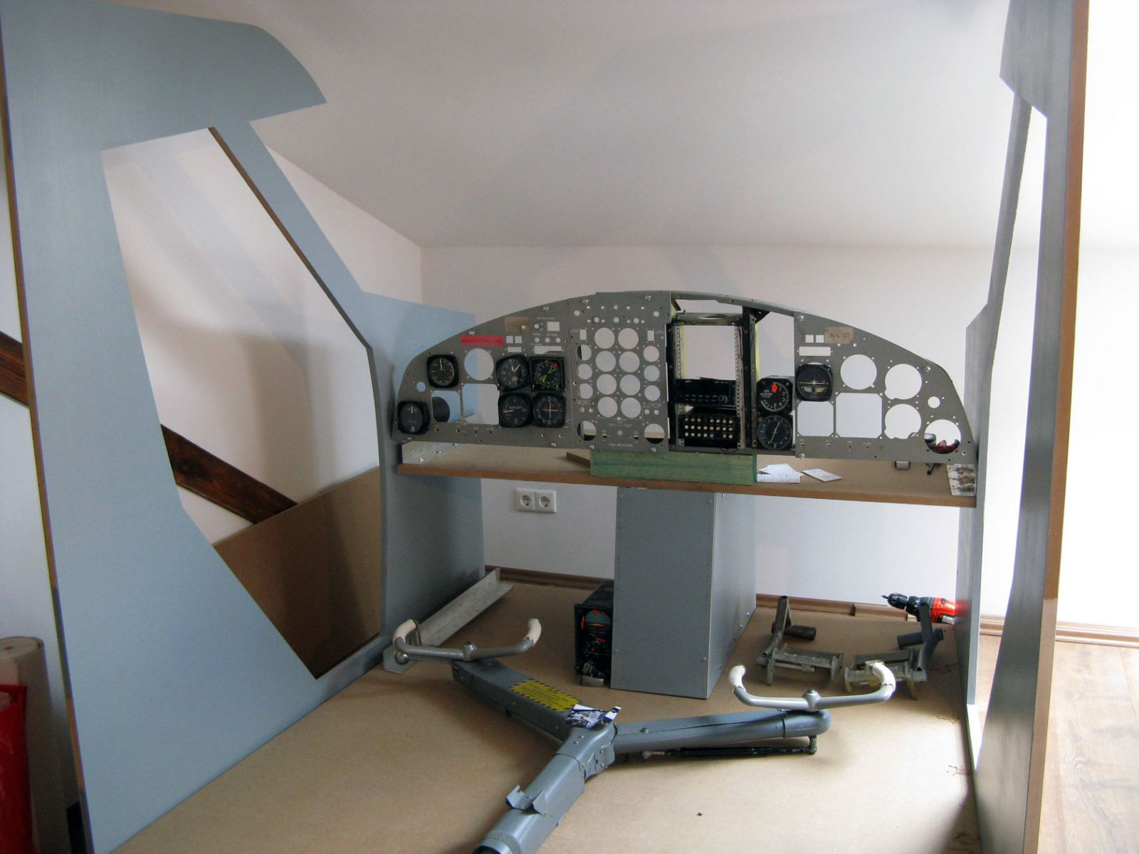 The shell of the Twin otter II cockpit (including the original yoke).