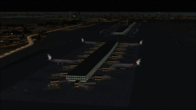Aerial view Dubai International Airport at night.