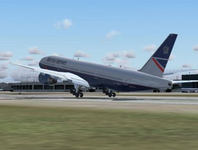 British Airways Boeing 777-236 taking off from runway.