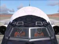 Screenshot of NASA pilots in the cockpit.